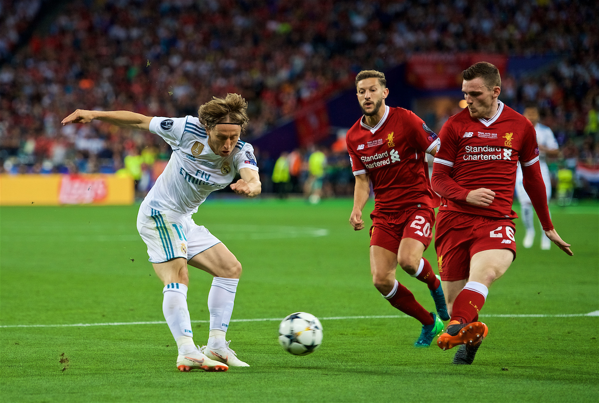 KIEV, UKRAINE - Saturday, May 26, 2018: Liverpool's Andy Robertson blocks a shot from Real Madrid's Luka Modrić during the UEFA Champions League Final match between Real Madrid CF and Liverpool FC at the NSC Olimpiyskiy.