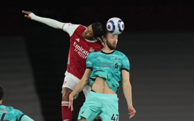 Liverpool's Nathaniel Phillips (R) challenges for a header with Arsenal's Pierre-Emerick Aubameyang during the FA Premier League match between Arsenal FC and Liverpool FC at the Emirates Stadium
