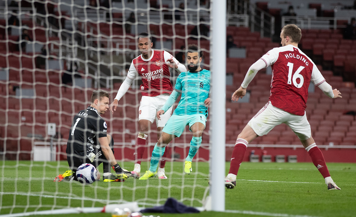 Liverpool's Mohamed Salah celebrates after scoring the second goal through the legs of Arsenal's goalkeeper Bernd Leno during the FA Premier League match between Arsenal FC and Liverpool FC at the Emirates Stadium