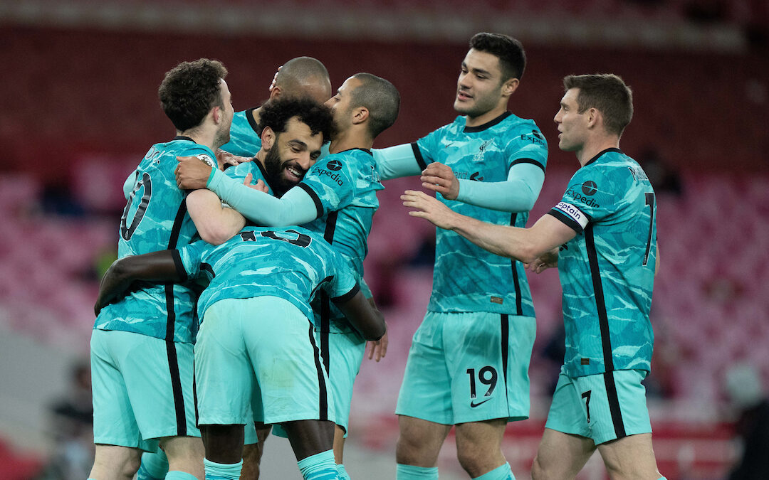 Liverpool's Mohamed Salah (C) celebrates after scoring the second goal during the FA Premier League match between Arsenal FC and Liverpool FC at the Emirates Stadium