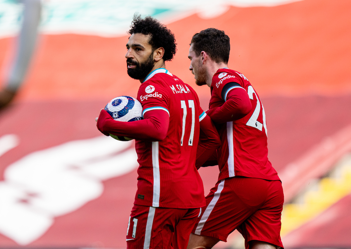 Liverpool's Mohamed Salah celebrates after scoring the first equalising goal during the FA Premier League match between Liverpool FC and Aston Villa FC at Anfield.