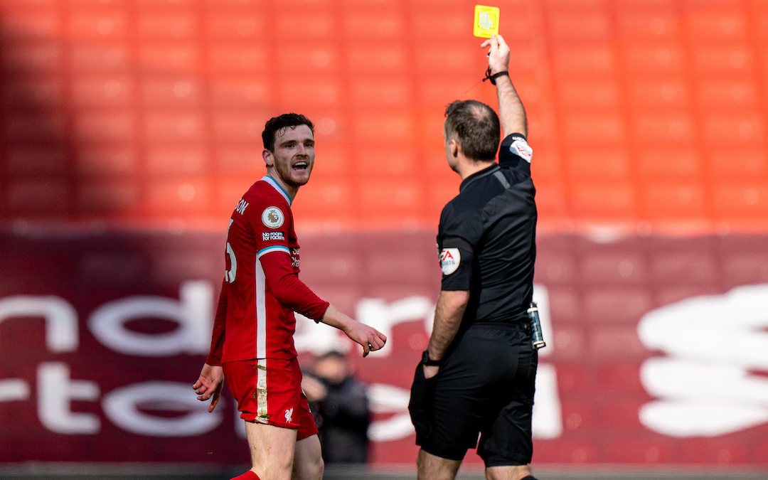 Saturday, April 10, 2021: Liverpool's Andy Robertson is shown a yellow card by referee Paul Tierney during the FA Premier League match between Liverpool FC and Aston Villa FC at Anfield.