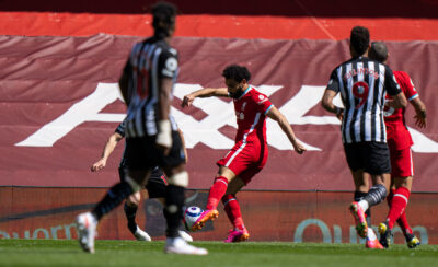 Liverpool's Mohamed Salah scores the first goal during the FA Premier League match between Liverpool FC and Newcastle United FC at Anfield.