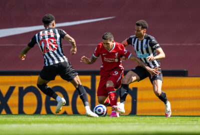 Liverpool's Roberto Firmino (C) is challenged by Newcastle United's Joe Willock (L) and Jacob Murphy (R) during the FA Premier League match between Liverpool FC and Newcastle United FC at Anfield.