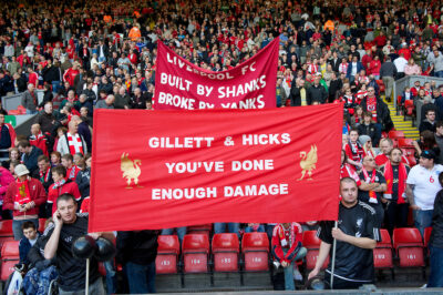"""September 25, 2010: Liverpool's supporters on the Spion Kop display a banner reading """"Gilett & Hicks You've Done Enough Damage"""" before the Premiership match at against Sunderland Anfield."""