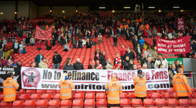 October 3, 2010: Liverpool supporters protest against American co-owners Tom Hicks and George N. Gillett Jr. after the side's embarrassing 2-1 defeat at home to Blackpool during the Premiership match at Anfield.