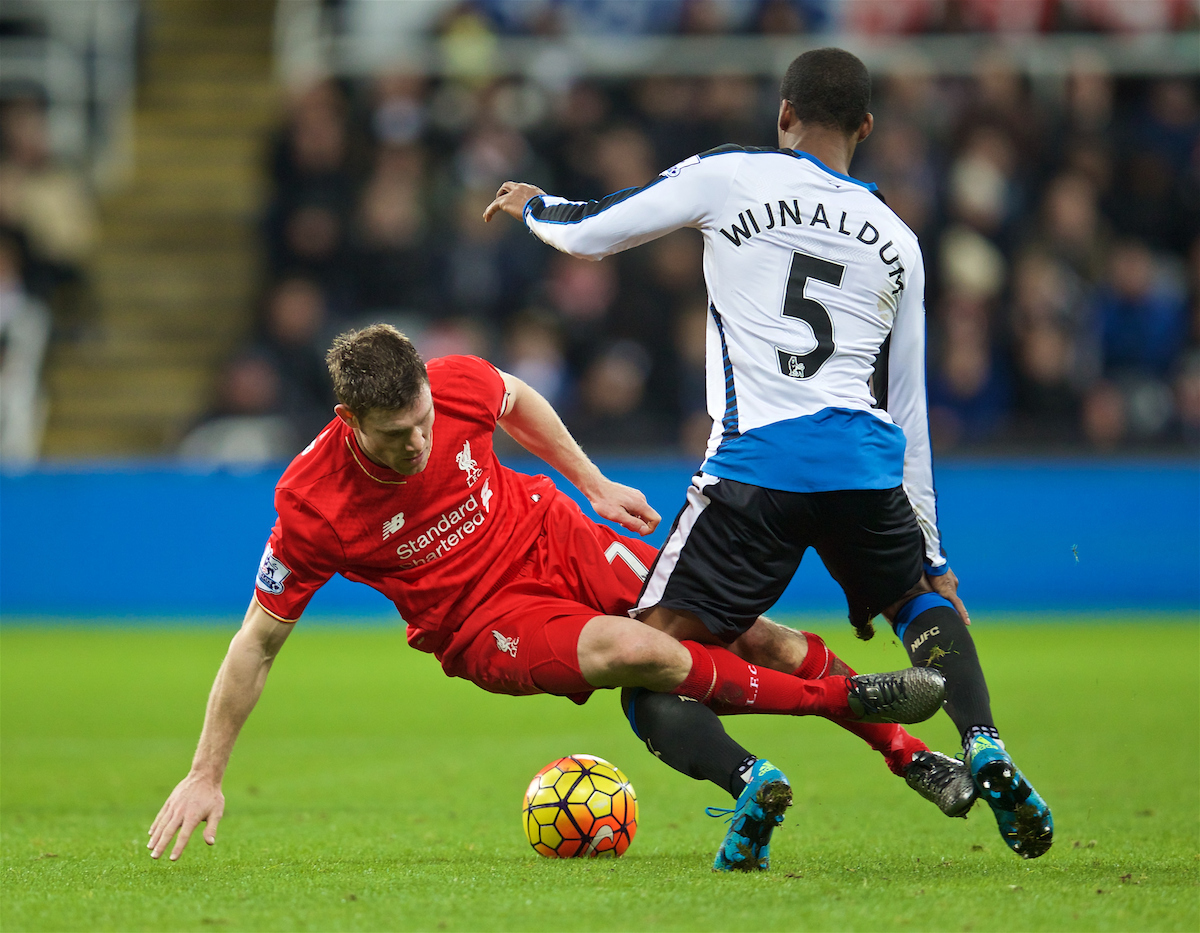 Liverpool's James Milner tackles Newcastle United's Gini Wijnaldum during the Premier League match at St. James' Park.