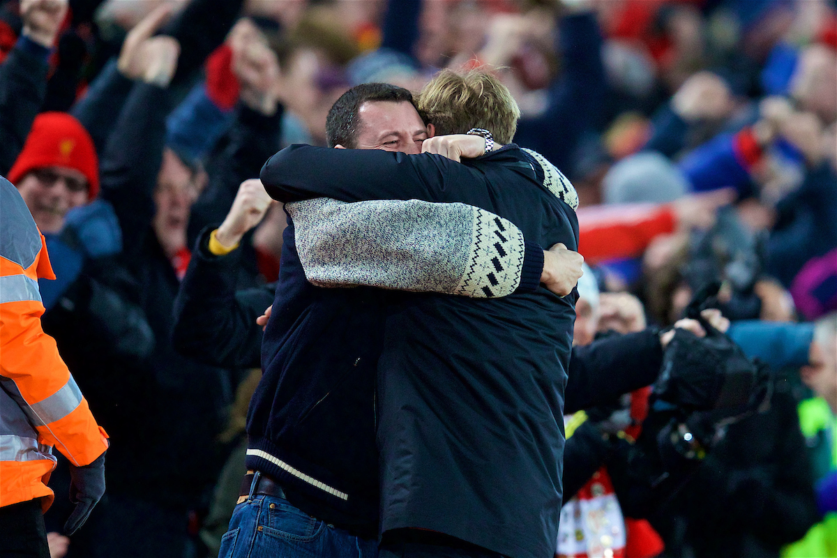 Liverpool manager Jurgen Klopp celebrates with a supporter at Anfield.
