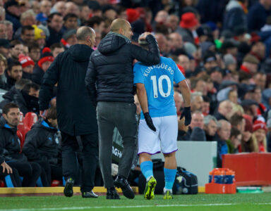 Manchester City's Sergio Aguero is substituted by head coach Pep Guardiola during the FA Premier League match between Liverpool FC and Manchester City FC at Anfield.