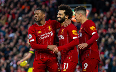 Liverpool's Mohamed Salah (C) celebrates scoring the third goal with team-mates Georginio Wijnaldum (L) and Roberto Firmino (R) during the FA Premier League match between Liverpool FC and Southampton FC at Anfield.