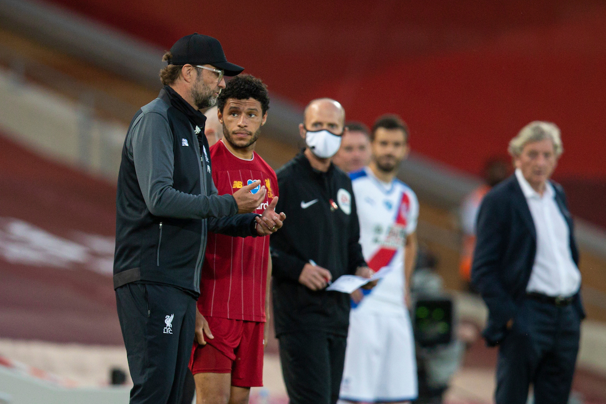 Liverpool's substitute Alex Oxlade-Chamberlain with manager Jurgen Klopp during the FA Premier League match between Liverpool FC and Crystal Palace FC at Anfield.