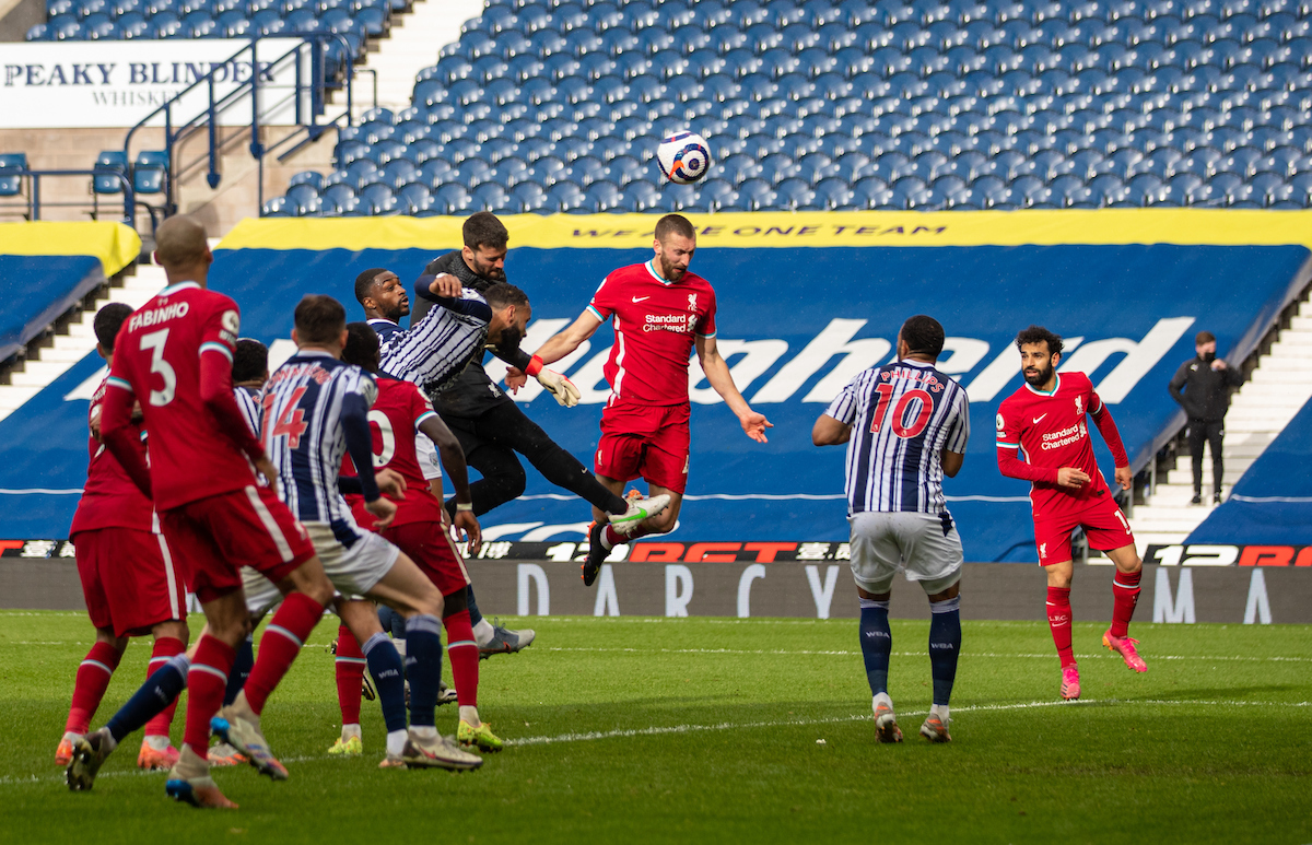 Alisson Becker scores the winning second goal with a head in injury time during the FA Premier League match between West Brom and Liverpool FC at The Hawthorns.