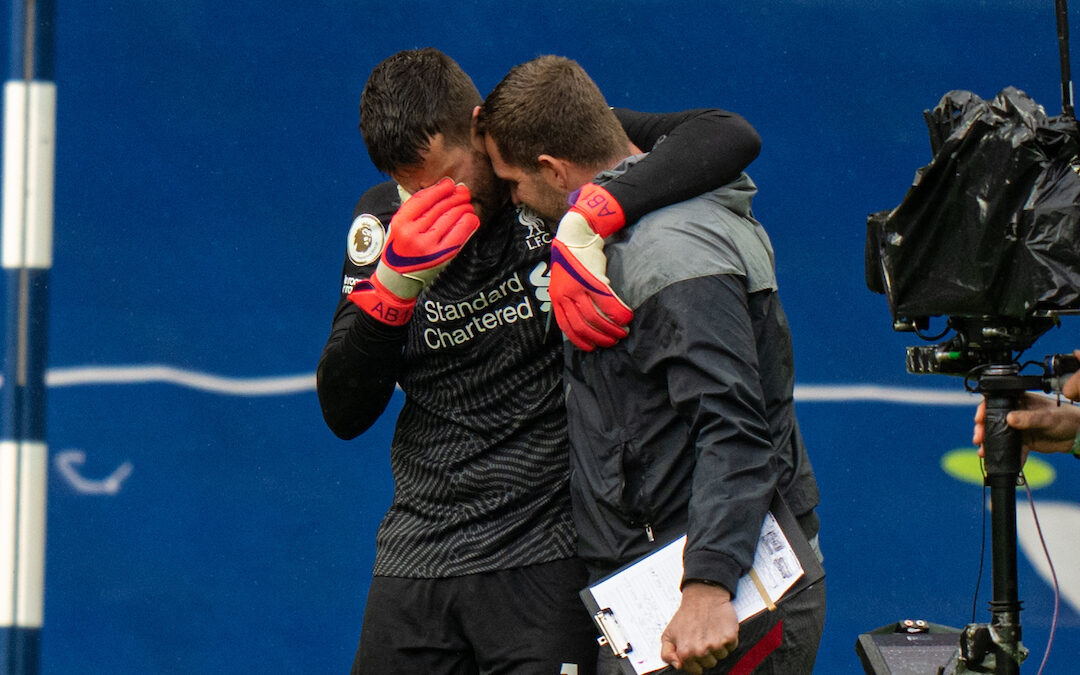 Liverpool's goalkeeper Alisson Becker with goalkeeping coach John Achterberg after scoring the winning goal in injury time during the FA Premier League match against West Brom