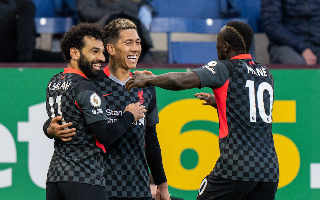 Liverpool's Roberto Firmino (C) celebrates with team-mates Mohamed Salah (L) and Sadio Mane (R) after scoring the first goal during the FA Premier League match between Burnley FC and Liverpool FC at Turf Moor.