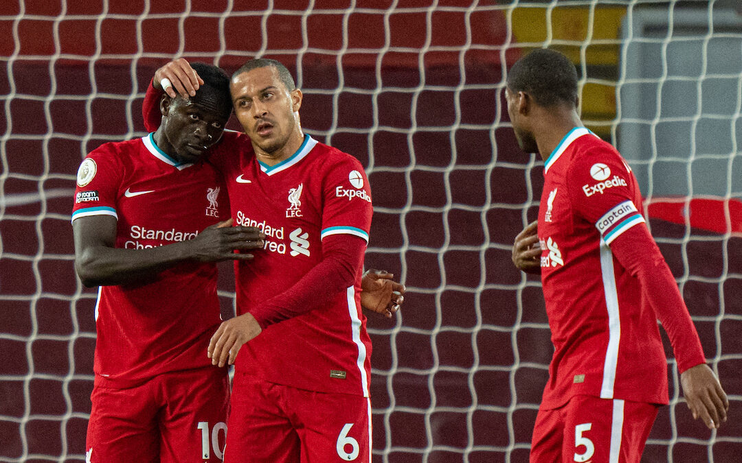 Liverpool's Sadio Mané (L) celebrates with team-mate Thiago Alcantara after scoring the first goal during the FA Premier League match between Liverpool FC and Southampton FC at Anfield.
