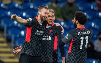 Liverpool's Nat Phillips (L) celebrates after scoring the second goal with team-mates Roberto Firmino (C) and Mohamed Salah (R) during the FA Premier League match between Burnley FC and Liverpool FC at Turf Moor.