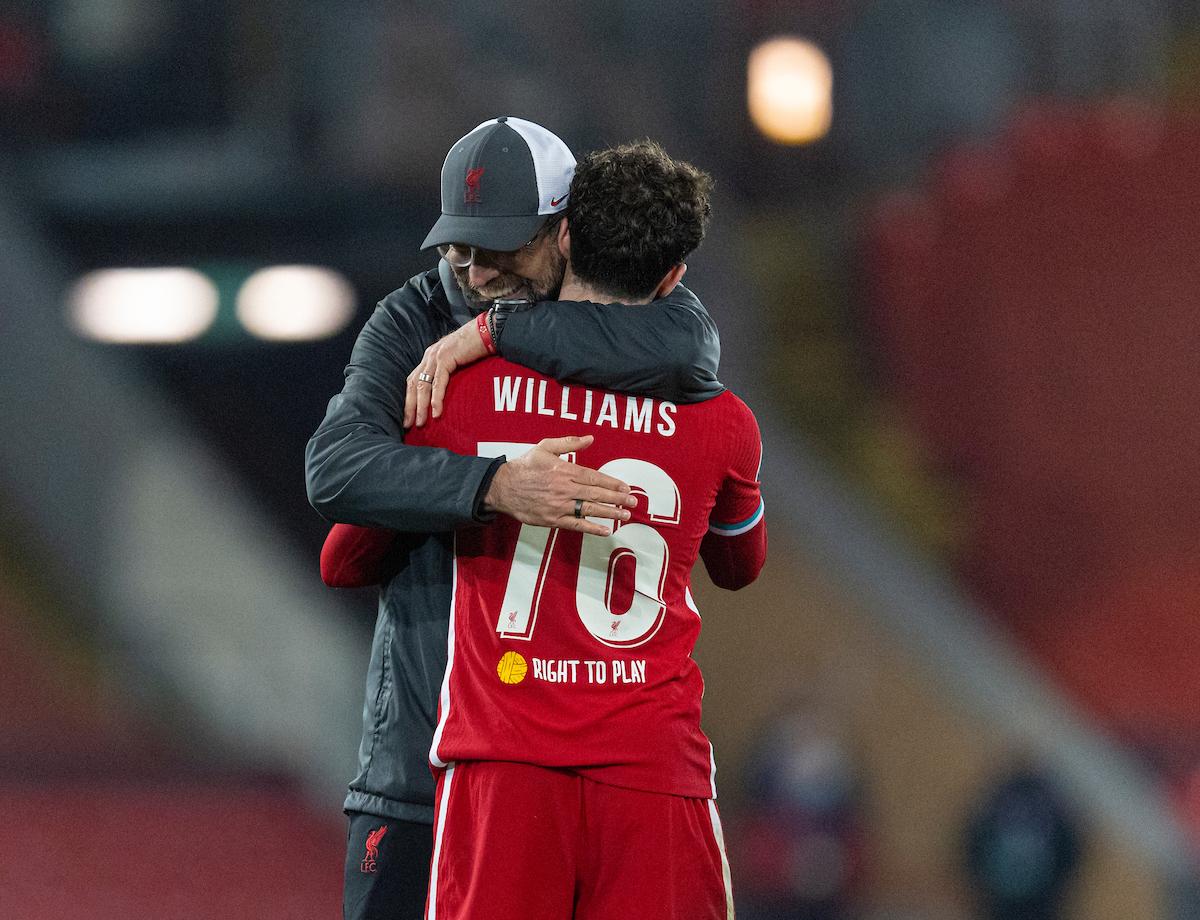 Neco Williams is embraced by Jurgen Klopp