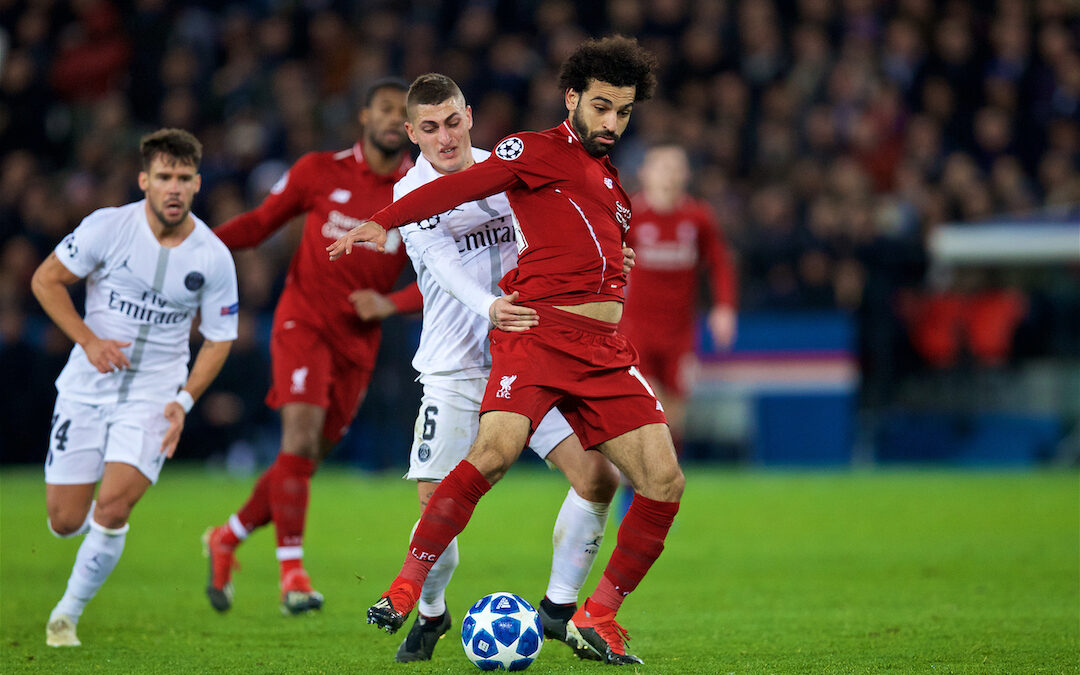 Mo Salah is pulled back by Paris Saint-Germain's Marco Verratti during the UEFA Champions League Group C match between Paris Saint-Germain and Liverpool FC at Parc des Princes.
