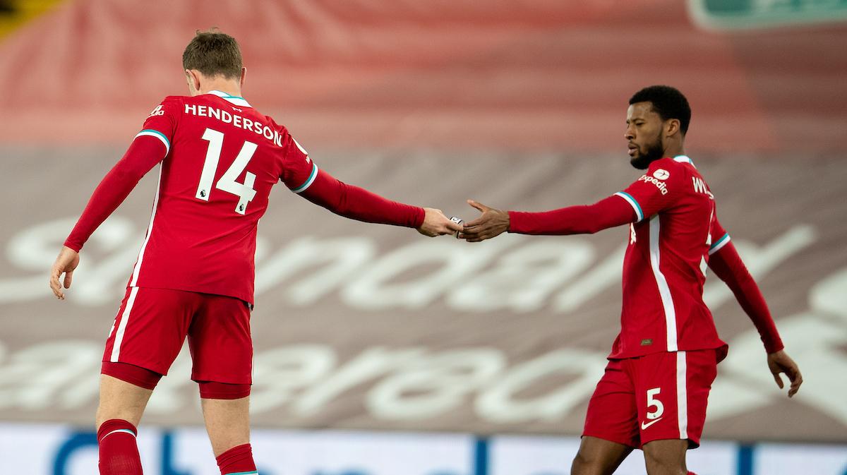 Liverpool's captain Jordan Henderson hands the captain's armband to Gini Wijnaldum
