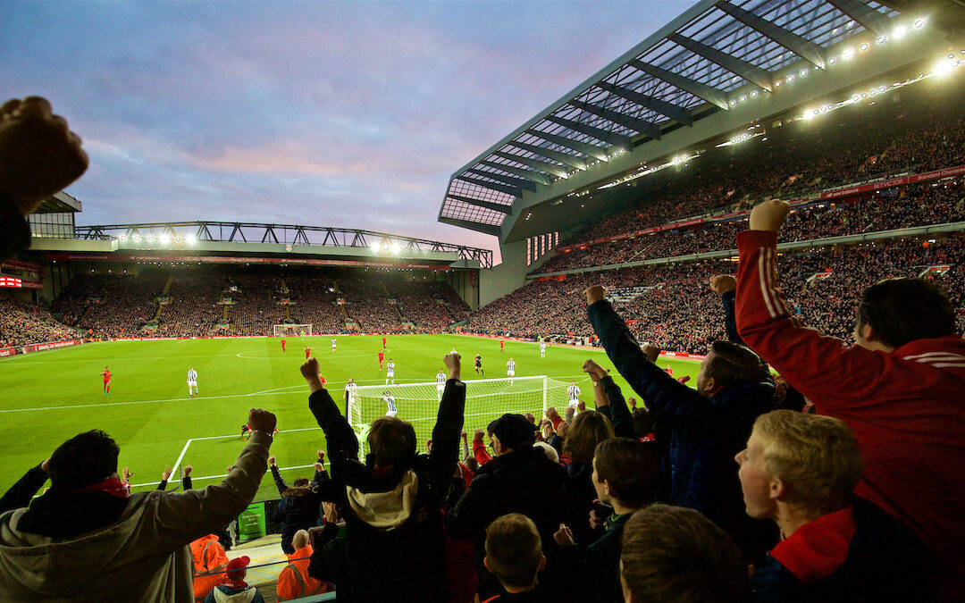 Liverpool supporters celebrate during a match at Anfield.