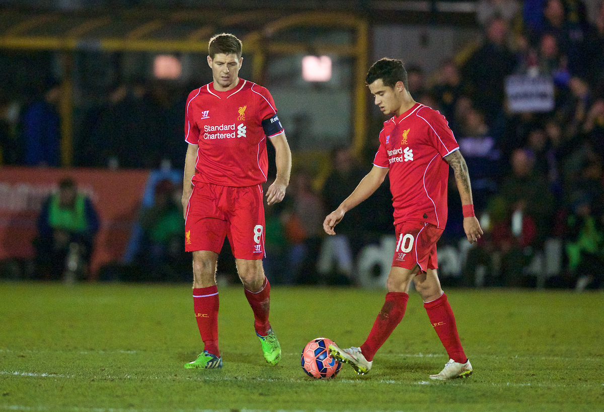 Liverpool's captain Steven Gerrard and Philippe Coutinho Correia look dejected as AFC Wimbledon score the opening goal during the FA Cup 3rd Round match at the Kingsmeadow Stadium
