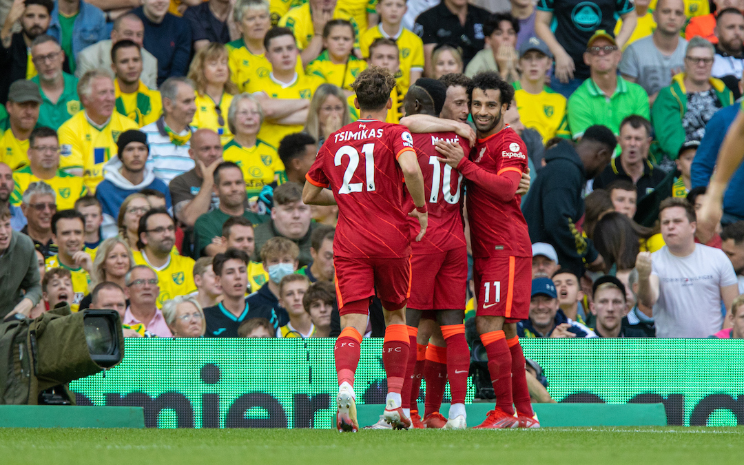 Liverpool's Diogo Jota (C) celebrates after scoring the first goal during the FA Premier League match between Norwich City FC and Liverpool FC at Carrow Road