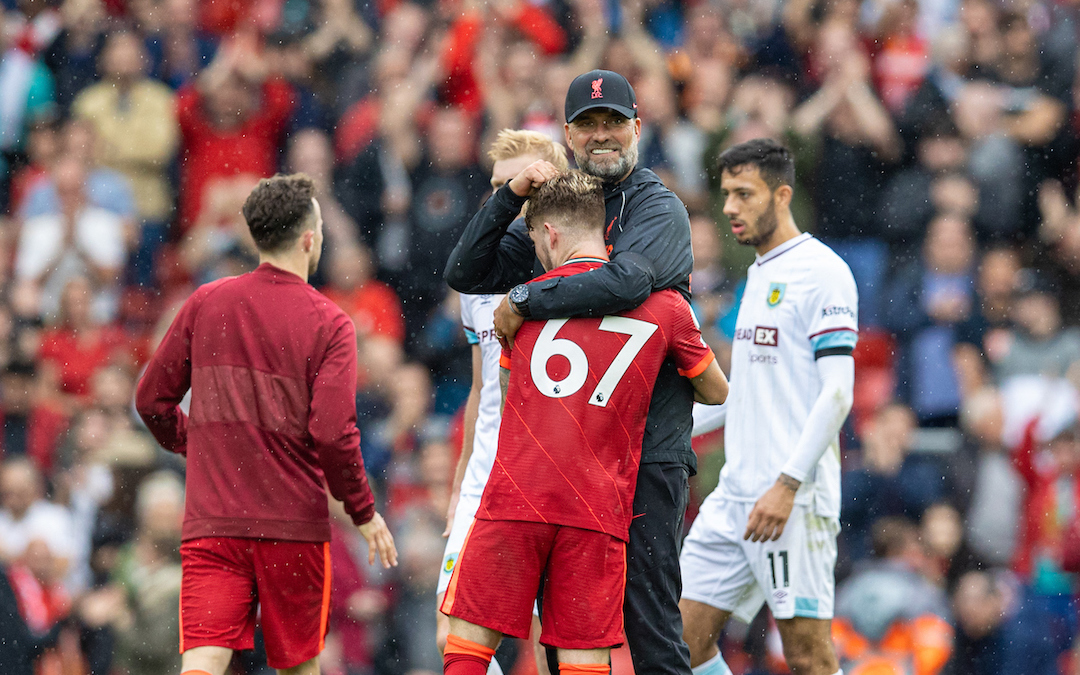 Liverpool's manager Jürgen Klopp embraces Harvey Elliott after the FA Premier League match between Liverpool FC and Burnley FC at Anfield