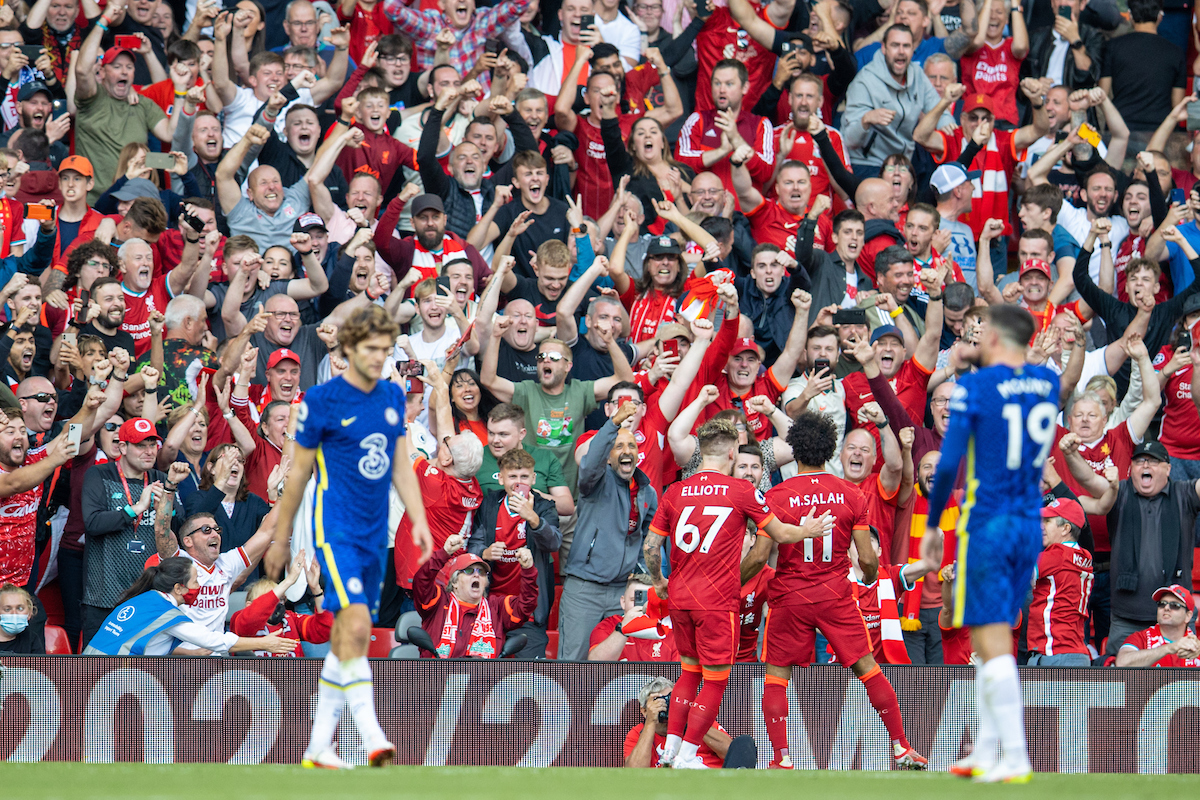 Liverpool's Mohamed Salah celebrates after scoring the first goal during the FA Premier League match between Liverpool FC and Chelsea FC at Anfield