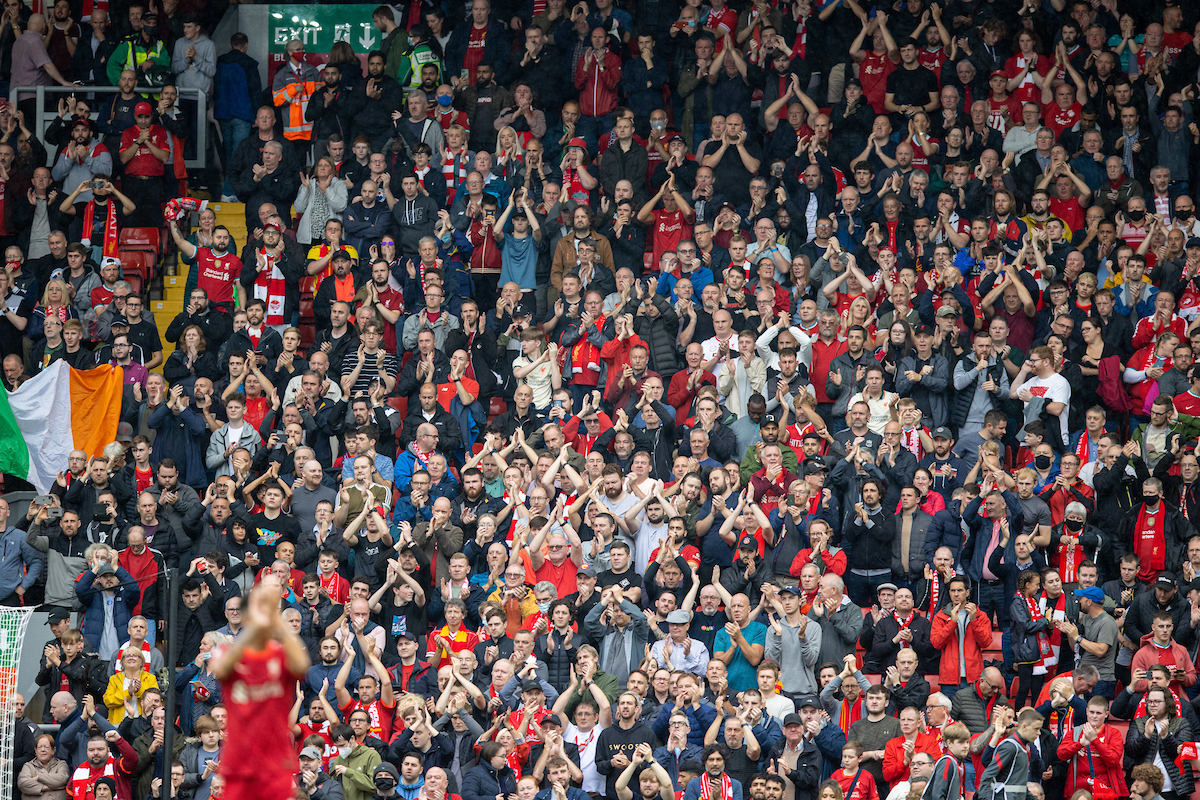 Liverpool supporters applaud the team after the FA Premier League match between Liverpool FC and Burnley FC at Anfield