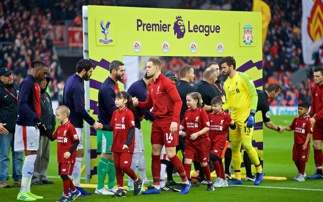 Liverpool's captain Jordan Henderson shakes hands with Crystal Palace's goalkeeper Julián Speroni before the FA Premier League match between Liverpool FC and Crystal Palace FC at Anfield