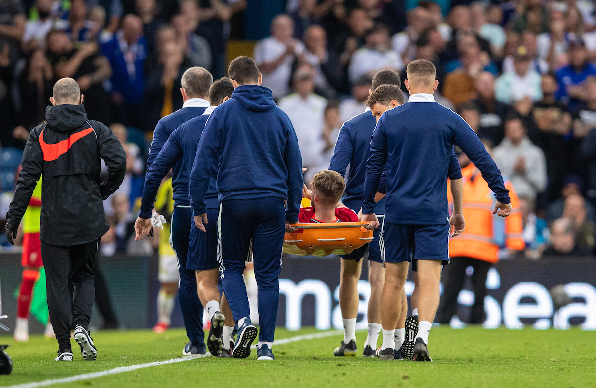 Liverpool's Harvey Elliott is carried off injured during the FA Premier League match between Leeds United FC and Liverpool FC at Elland Road