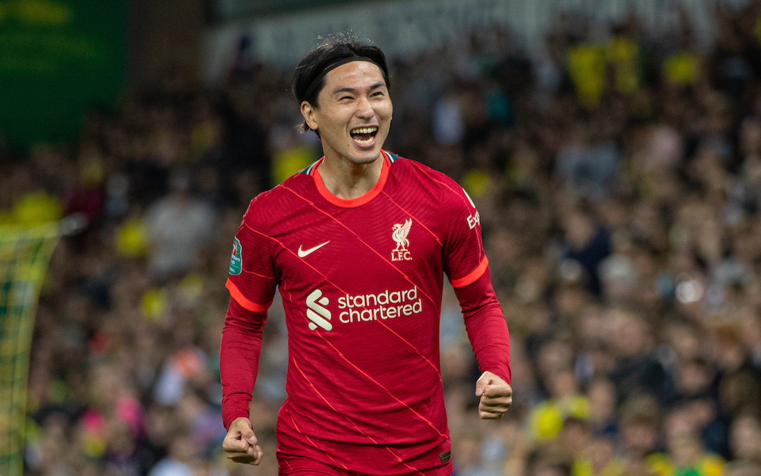 Liverpool's Takumi Minamino celebrates after scoring the first goal during the Football League Cup 3rd Round match between Norwich City FC and Liverpool FC at Carrow Road
