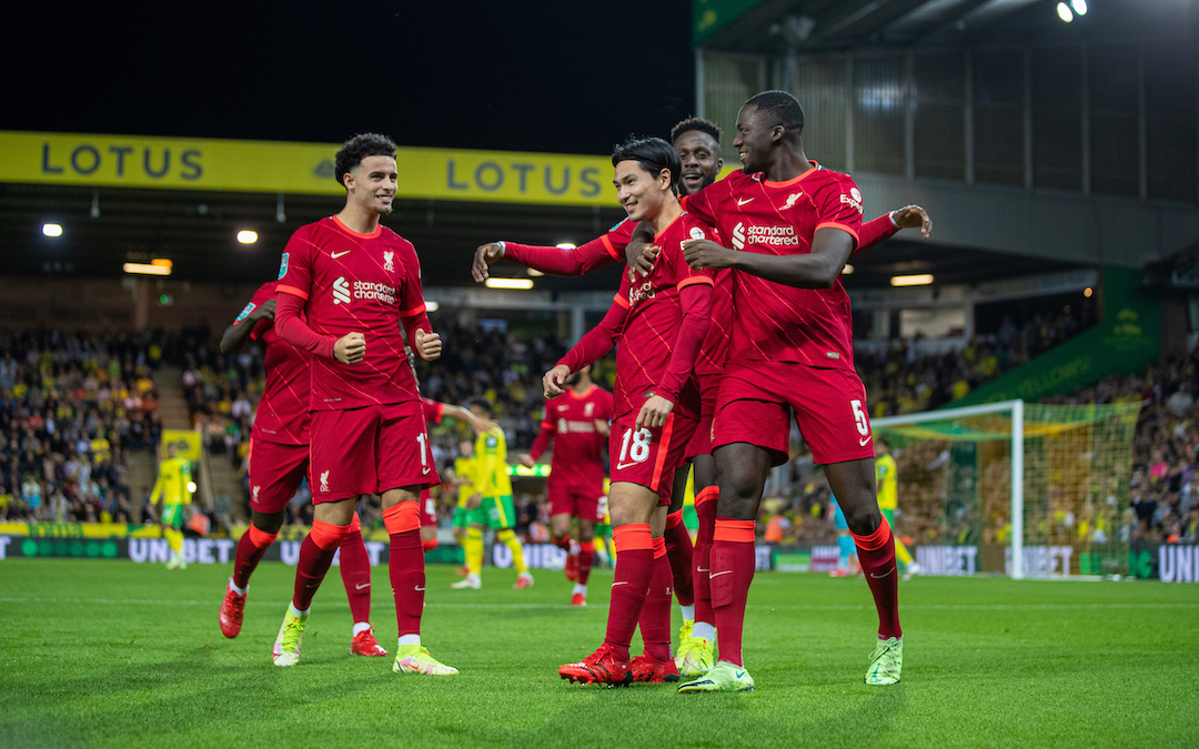 Liverpool's Takumi Minamino (C) celebrates with team-mates after scoring the first goal during the Football League Cup 3rd Round match between Norwich City FC and Liverpool FC at Carrow Road